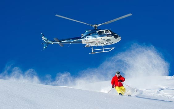 Glide-down-the-snow-capped-mountains--Heli-Skiing